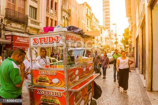 Rio de Janeiro, Brazil - September 20, 2018: People buying hotdogs at streets in Rio de Janeiro's Downtown.