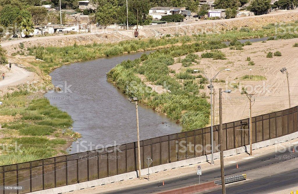 Rio Grande along Border Security Wall royalty-free stock photo