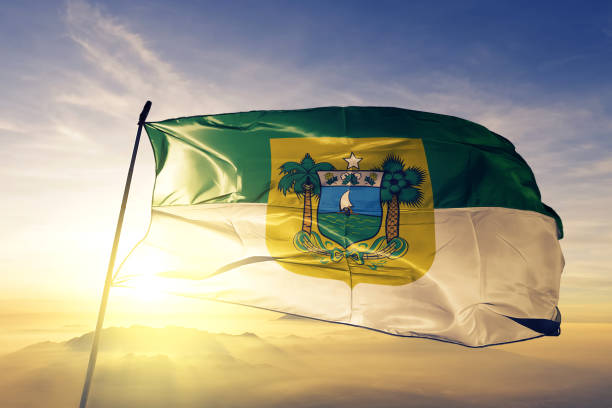 Rio Grande do Norte state of Brazil flag textile cloth fabric waving on the top sunrise mist fog stock photo