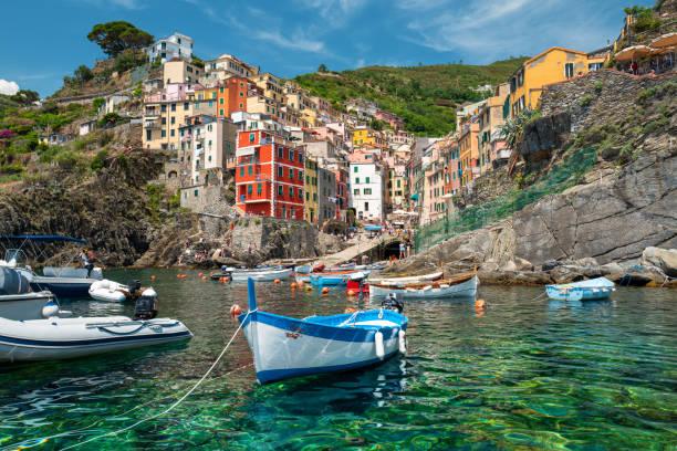 Riomaggiore coastline, Cinque Terre, Italy Sea view of Riomaggiore village in Cinque Terre, Italy. rocky coastline stock pictures, royalty-free photos & images