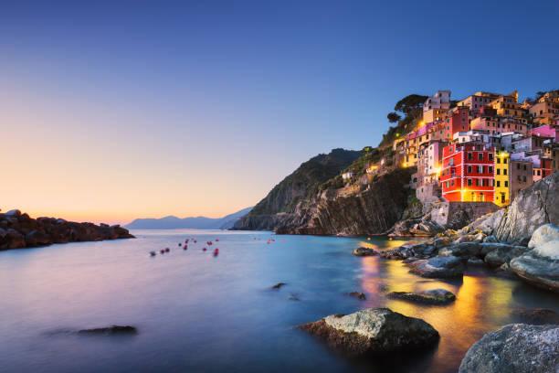 riomaggiore town, cape sea landscape sunset. cinque terre, liguria, italy - la spezia foto e immagini stock