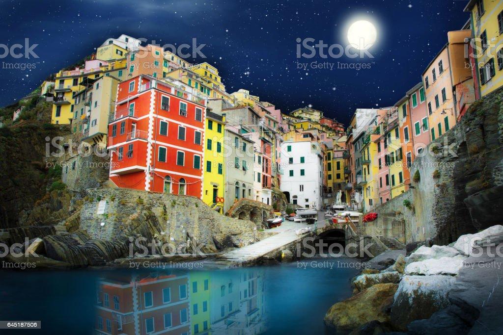 Riomaggiore village by night , Cinque Terre , Italy stock photo
