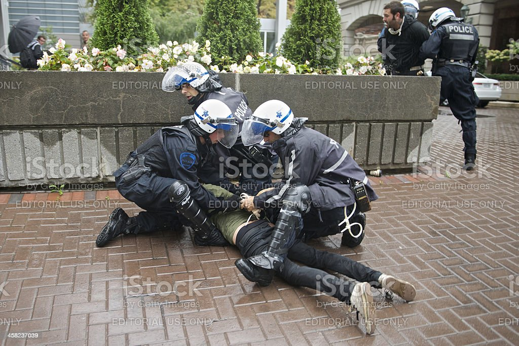 Riot Police Arrest Protester stock photo