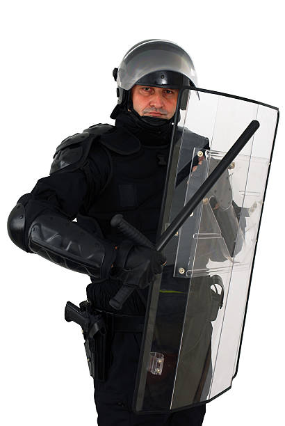 Riot police officer with Barton and Perspex shield policeman with full anti riot equipment riot police stock pictures, royalty-free photos & images