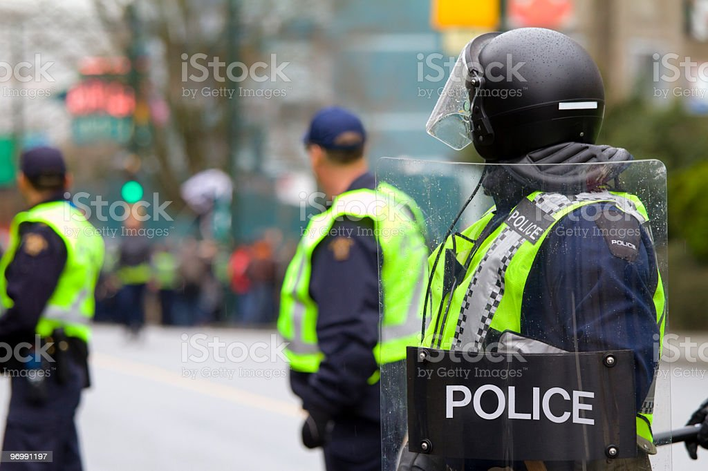 Riot police on alert stock photo