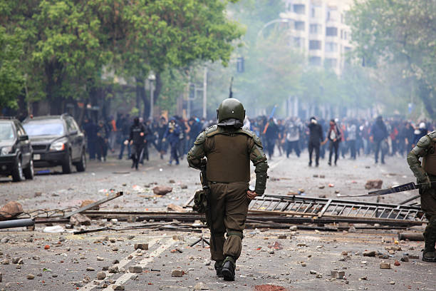 Riot Police Riot police during a student strike in Santiago, Chile. riot stock pictures, royalty-free photos & images