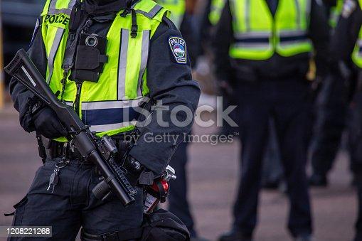 Riot policemen with gas gun in hand
