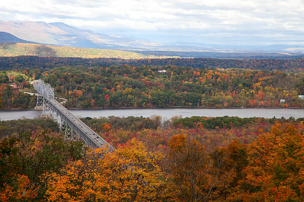 """Rip Van Winkle Bridge in Autumn, New York """"View from Olana, Frederic Church's mountainside estate, looking to the Catskills and the Hudson River. Vibrant hardwood forests in brilliant autumn color."""" catskill mountains stock pictures, royalty-free photos & images"""