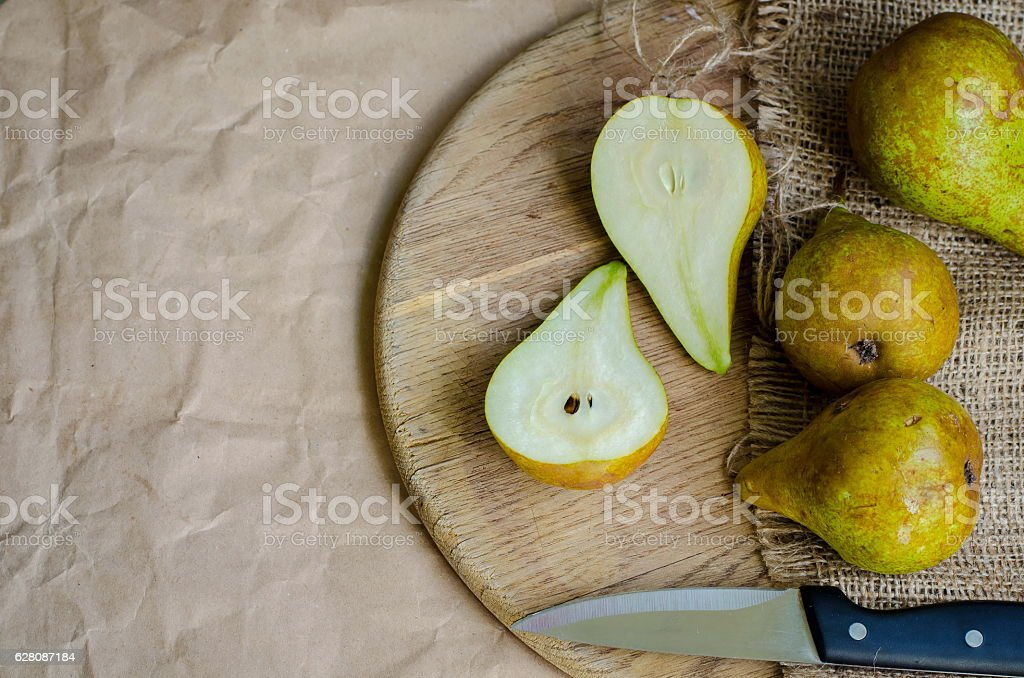 Ripe and juicy pears on background of packing paper stock photo