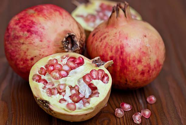 Ripe and sweet pomegranates stock photo