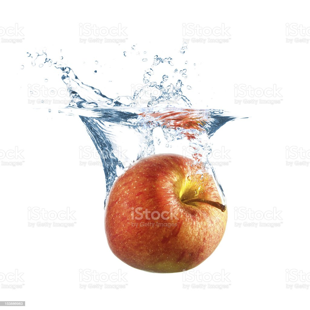 Ripe apple fall into water stock photo