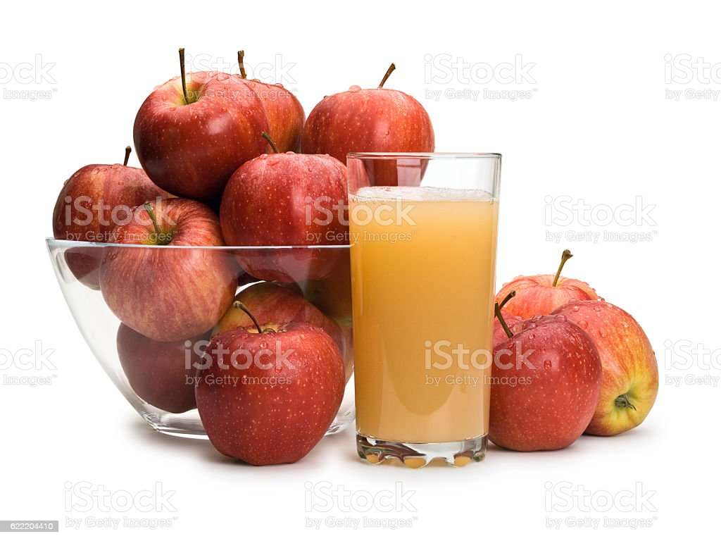 Ripe apples and juice with pulp stock photo