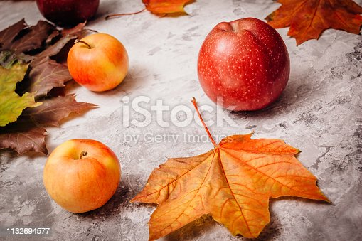 istock Ripe apples on a gray background 1132694577