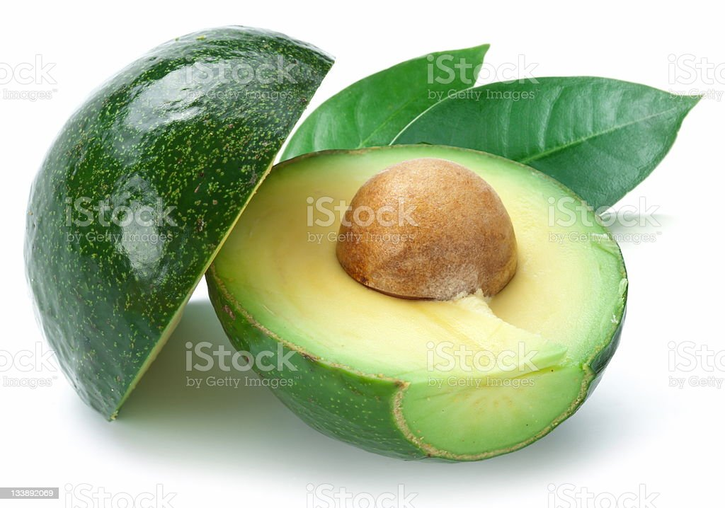 Ripe avacados with leaves. stock photo