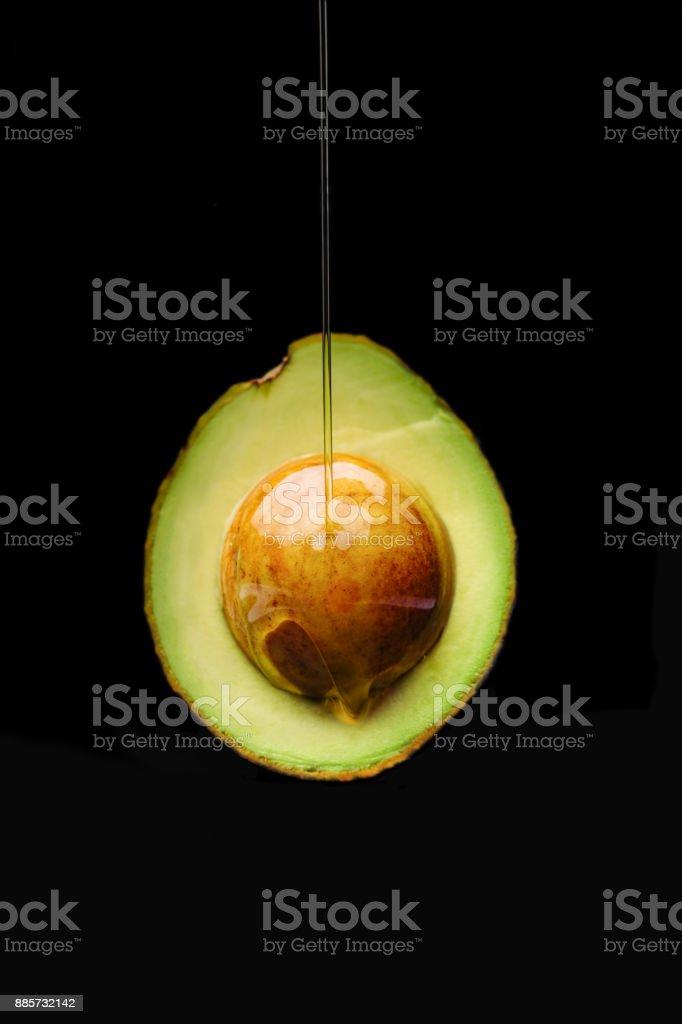 Ripe avocado cut in half on black background stock photo