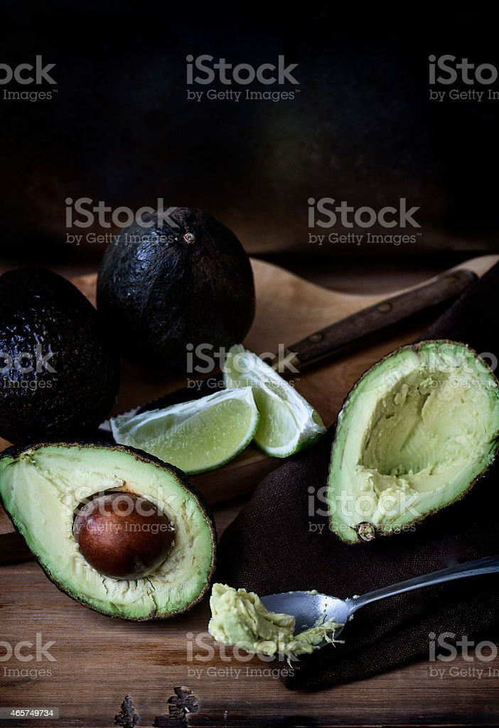 Ripe avocado on a wooden board. stock photo