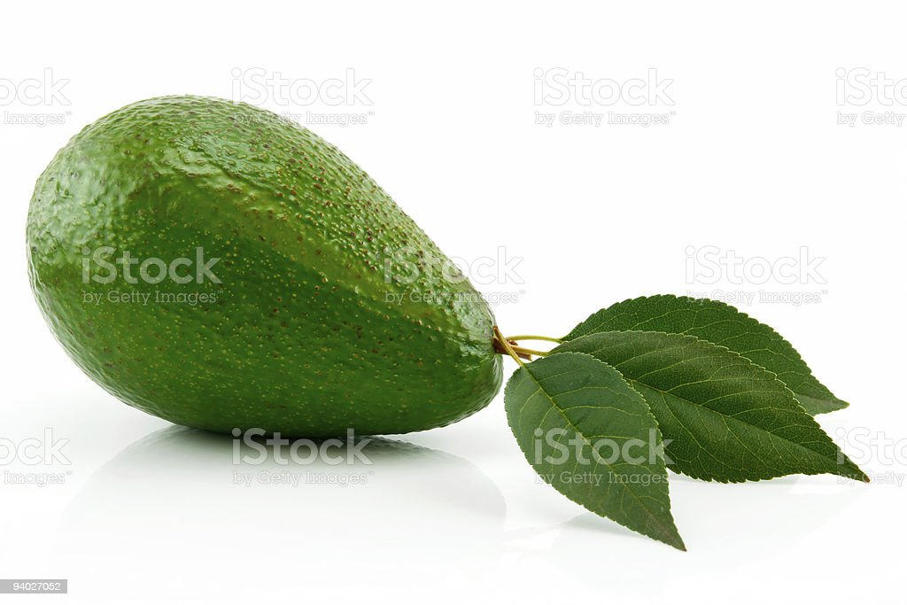 Ripe Avocado With Green Leaf Isolated on White royalty-free stock photo