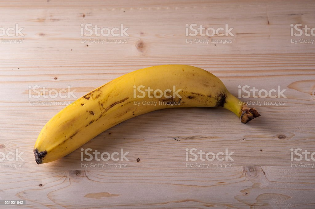 Ripe banana on wooden table foto stock royalty-free