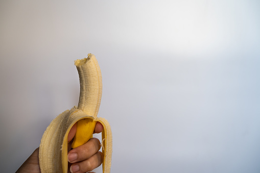 Ripe bananas are peeled, and have bite marks, white back.
