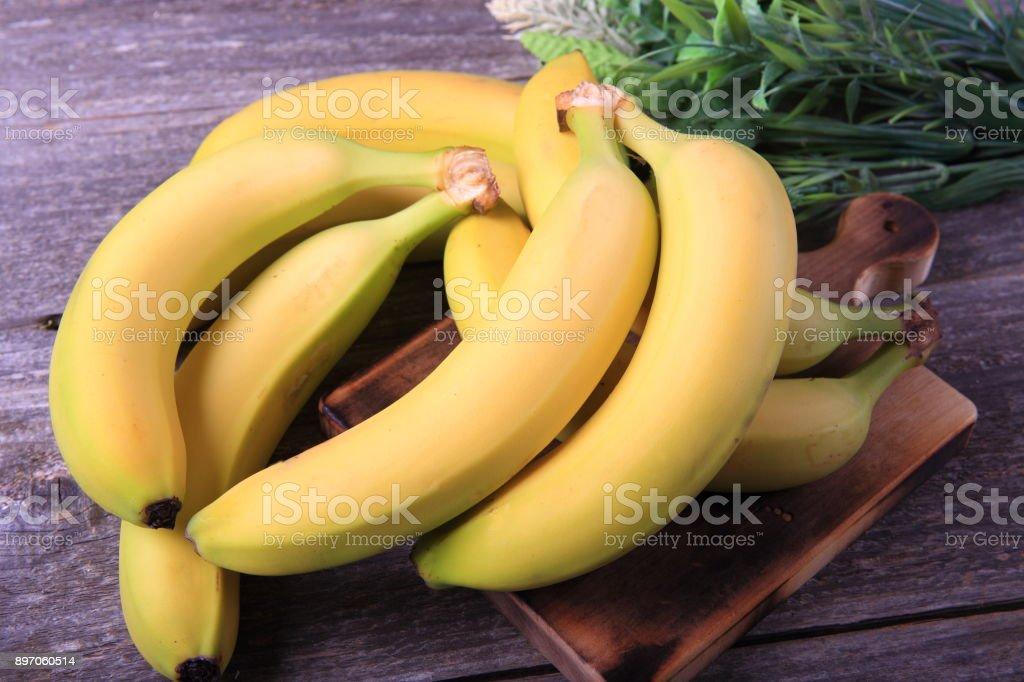 Ripe bananas on wooden table stock photo
