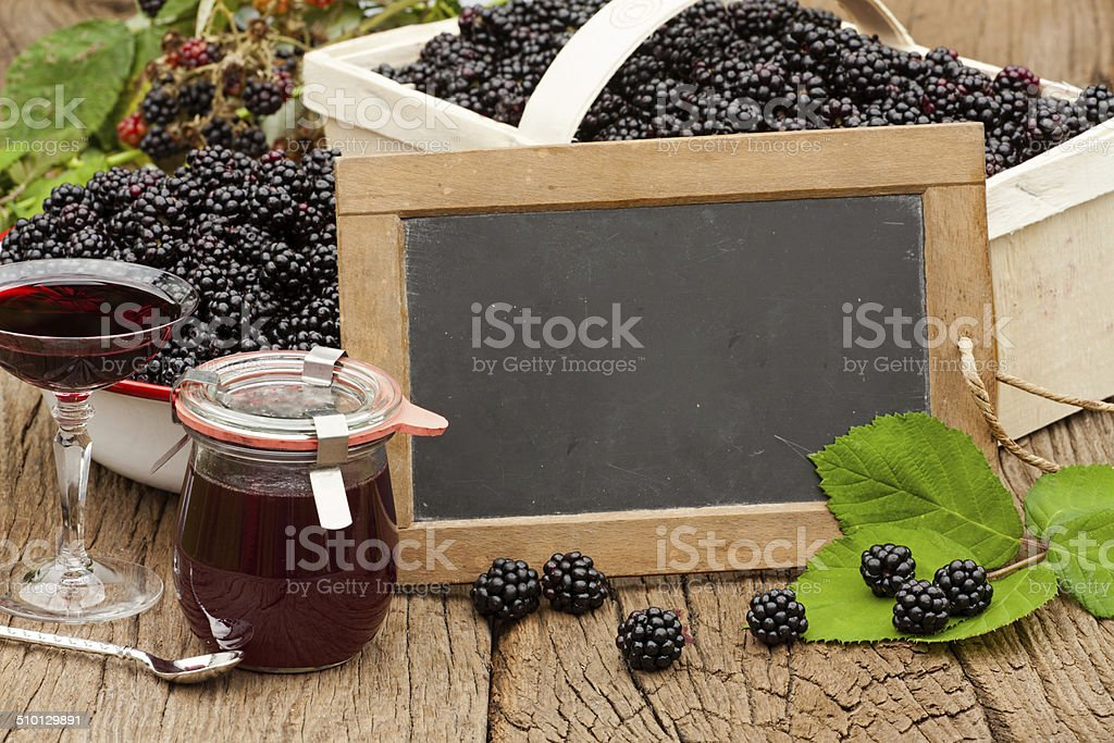 Ripe blackberries and a jar blackberry jelly stock photo