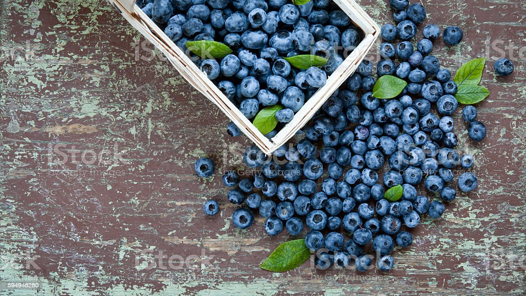 Ripe blueberries on table stock photo