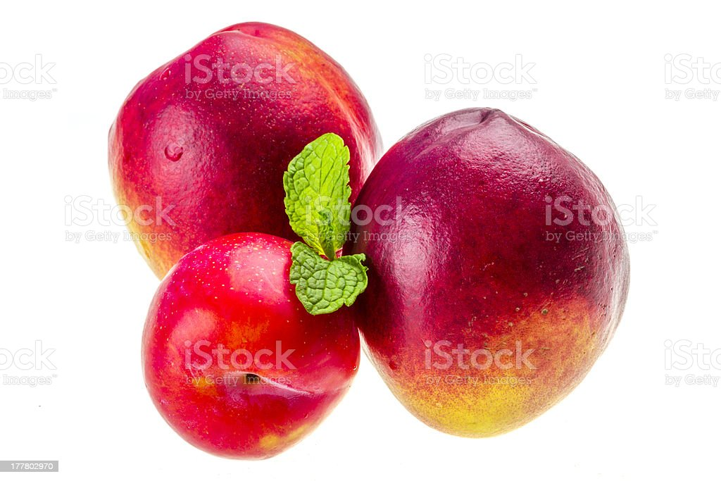Ripe bright peaches, plum and mint royalty-free stock photo
