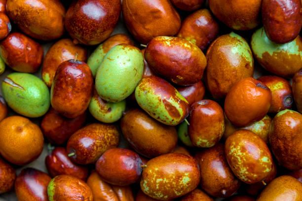 Ripe broun jujube chinese dates, close up stock photo