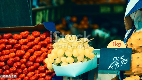 istock Ripe bunch of grapes in carton box. Toned picture 984684238