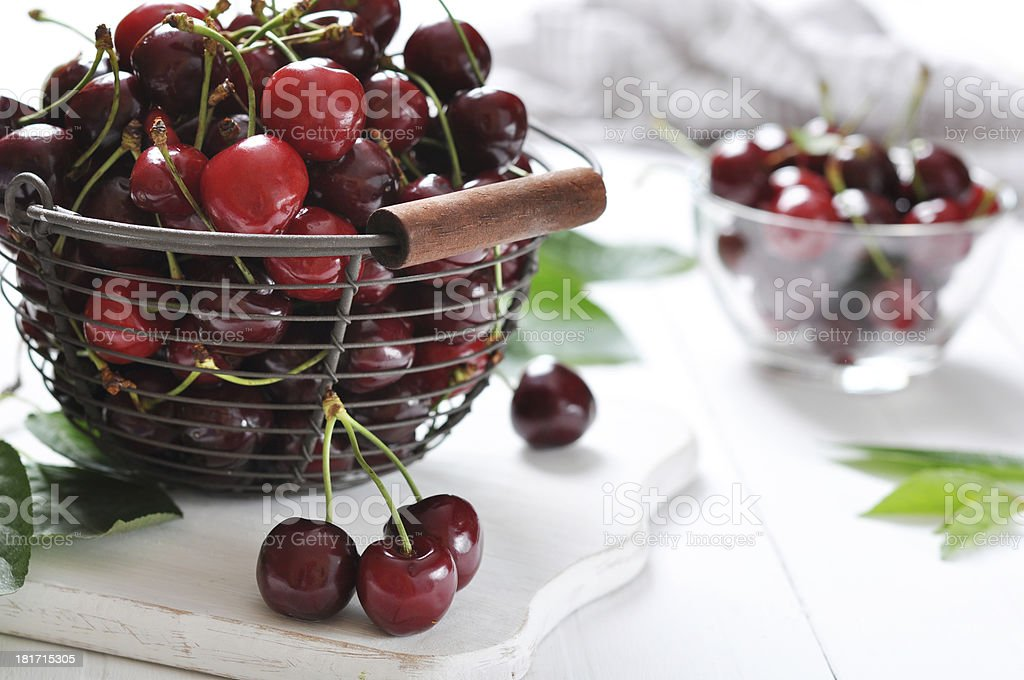Ripe cherries in a metal basket royalty-free stock photo