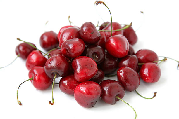 Ripe cherry on a white background with drops of water – Foto