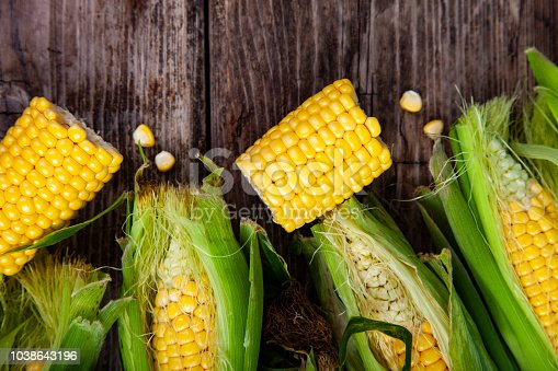 Ripe corn on an old wooden table.