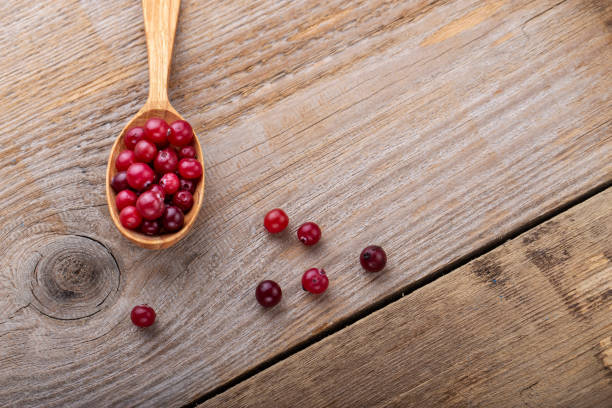 Ripe cranberries in a wooden spoon. stock photo