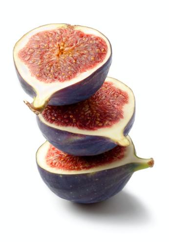 Ripe fig fruits on white background