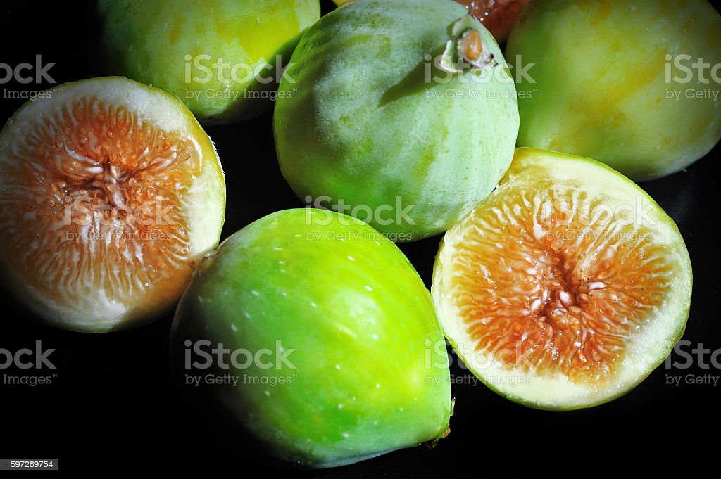 Ripe figs on a black background royalty-free stock photo