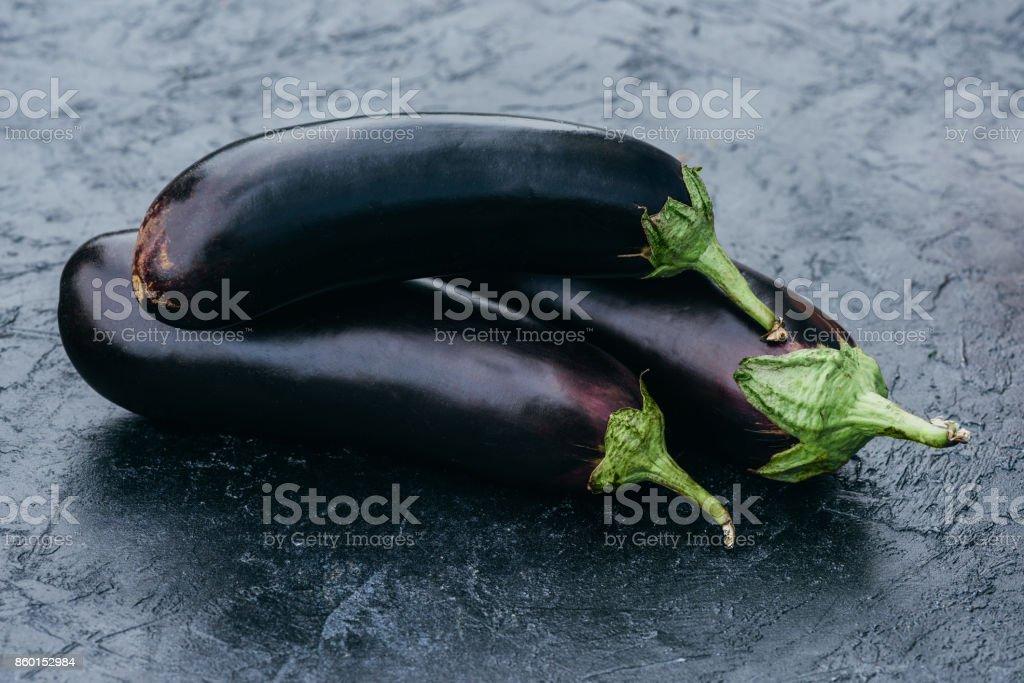 ripe fresh eggplants on black stock photo