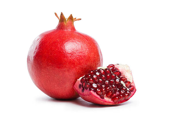 ripe fresh pomegranate fruit. - pomegranate stock photos and pictures