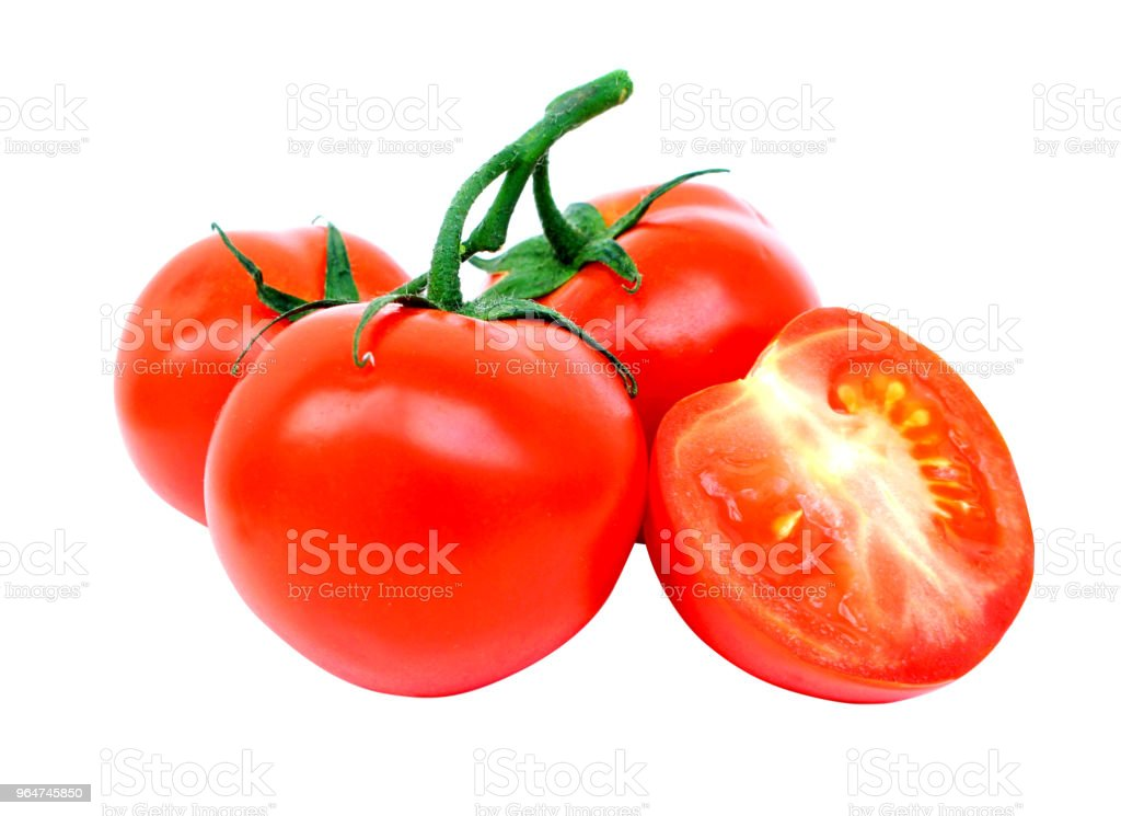 Ripe fresh tomatoes on a sprig and half tomatoes isolated on a white background without a shadow. Close up royalty-free stock photo