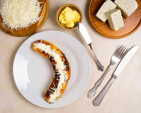 High angle view of sweet delicious food of fried plantain with white cheese.In the image are white cheese and butter.