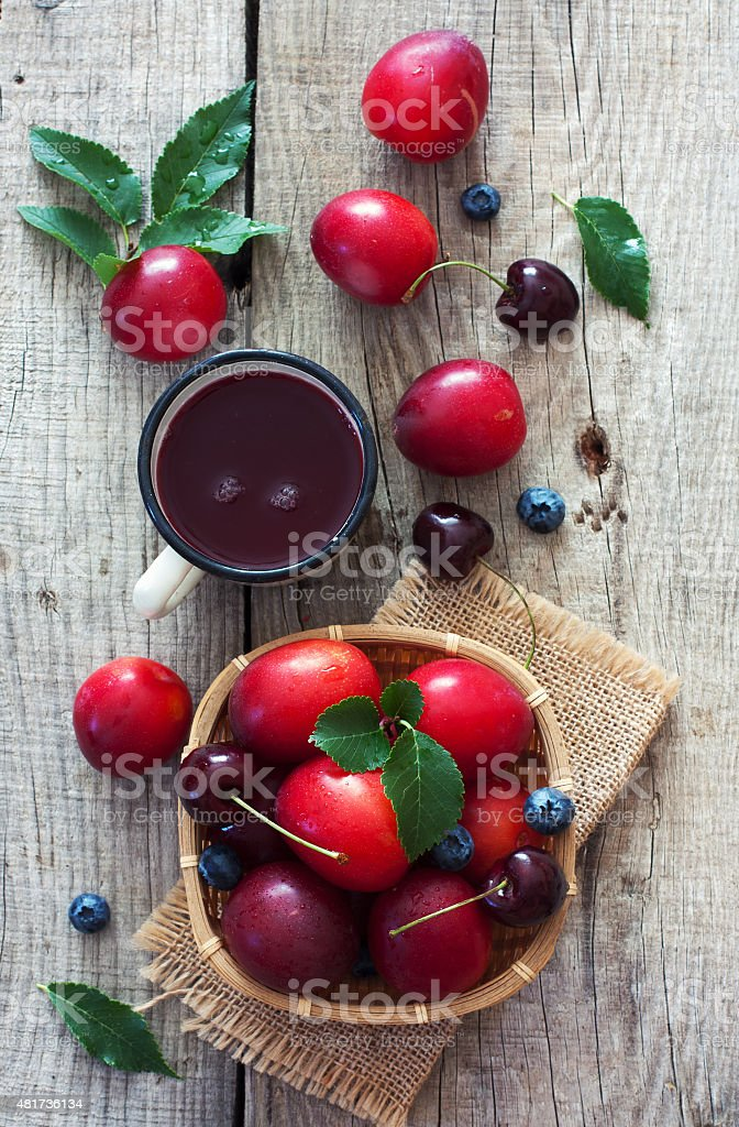 Ripe fruits and cup of juice stock photo