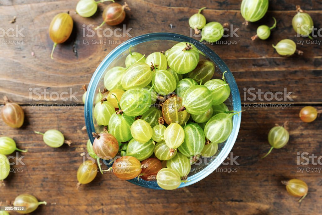 Ripe gooseberry in a glass plate stock photo