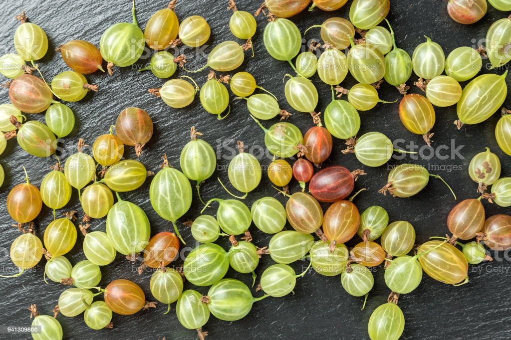 Ripe gooseberry strewn with dense background, bright berry background stock photo