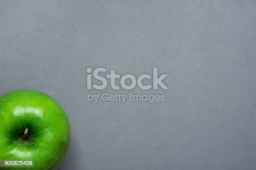 istock Ripe Green Apple on Grey Stone Background Tabletop. Flat Lay Top View Thanksgiving Harvest Autumn Fall Gratefulness. Vegan Food Logo Website Template Copy Space. Creative Conceptual Image 900825438
