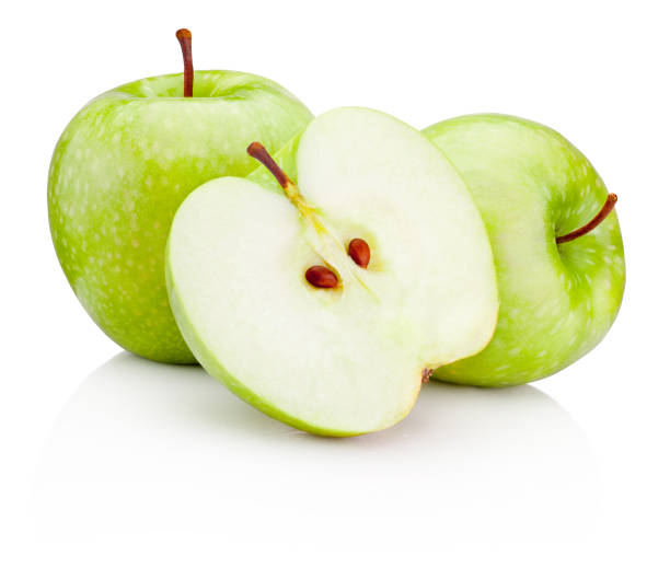 Ripe green apples and half isolated on a white background Ripe green apples and half isolated on a white background granny smith apple stock pictures, royalty-free photos & images