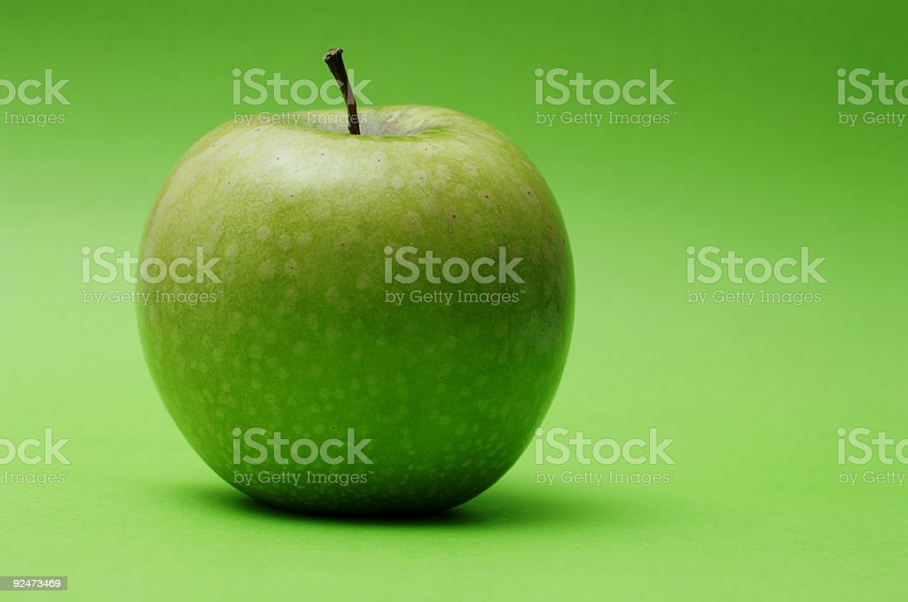 ripe healthy  apple against green background royalty-free stock photo