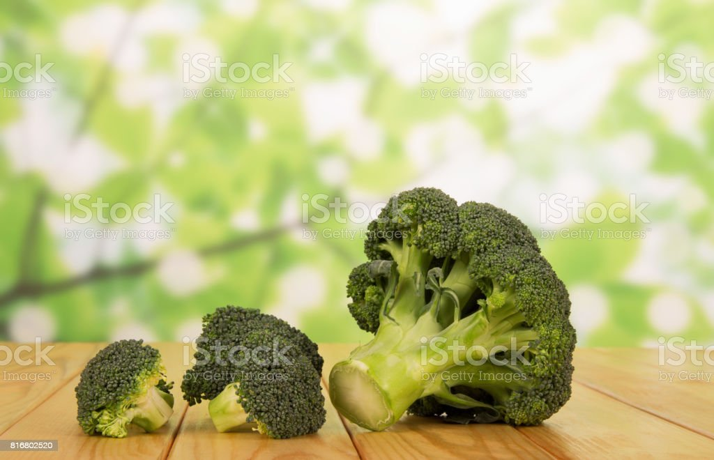 Ripe inflorescences of broccoli on an abstract green. stock photo