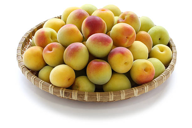 ripe japanese apricot - 熟した ストックフォトと画像
