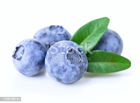 853493518 istock photo Ripe juicy blueberries with leaves isolated on a white background. 1226798731