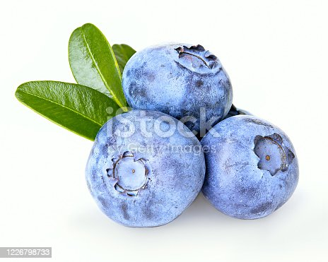 853493518 istock photo Ripe juicy blueberries with leaves isolated on a white background. 1226798733