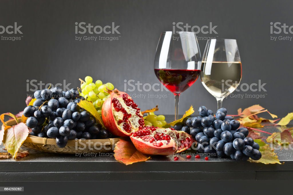 Ripe juicy grape and glass of wine stock photo